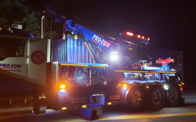 Semi-Truck Accident Spills Container of Clothing on Highway 18